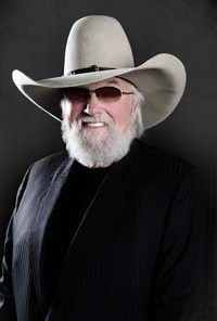 Charlie Daniels black shirt and cowboy hat