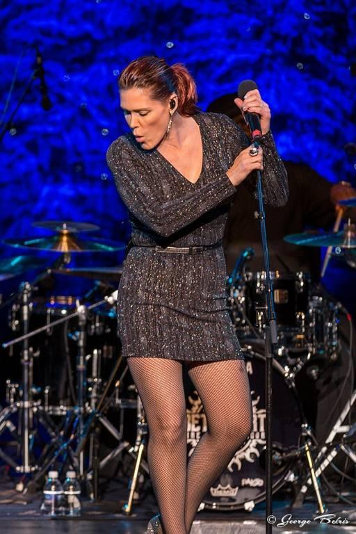 beth hart on stage live black fishnet stockings